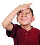 Kid slaps himself on head, oh-no, isolated on white