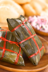Peruvian tamales wrapped in banana leaves