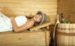 woman  on wooden bench in sauna