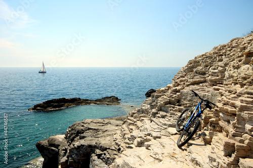 Bike, rocks and boat
