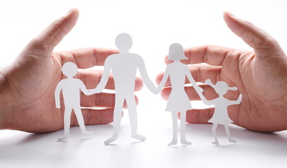Cardboard figures of the family on a white background.