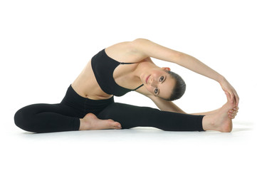Photo of young woman exercising yoga