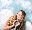 Blond angel with silver heart, stars and snowflakes