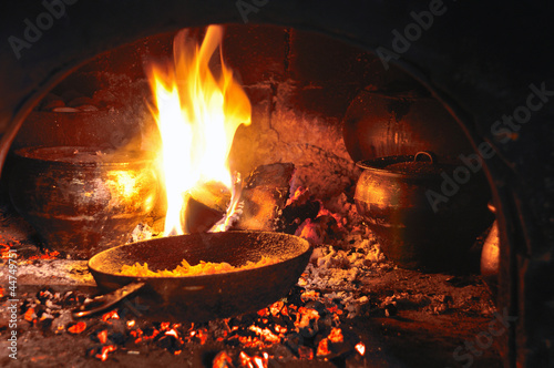 cooking in an old fireplace