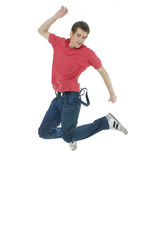 casual young man jumping