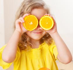 Child with orange