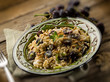 risotto with mushroom grape and pine cone, selective focus