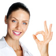 Cheerful businesswoman with okay sign, over white