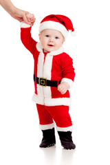 first steps of cute baby Santa claus