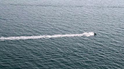 Jet Ski in Action on Blue Sea