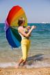 Teenage girl carrying iridiscent umbrella