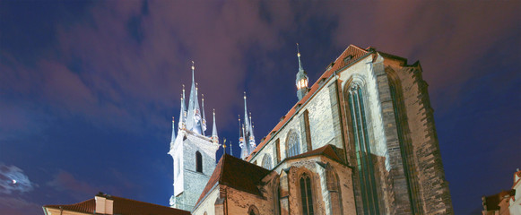 Towers of light in the night in Prague
