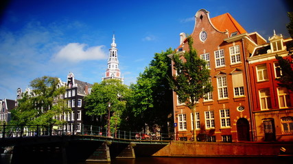 Streets, canals, bridges, buildings, boats in Amsterdam, Holland