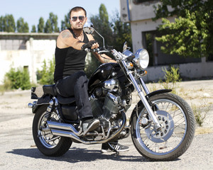 Young man on a chopper motorcycle