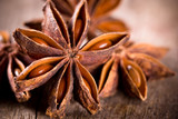 Anise stars on wooden background