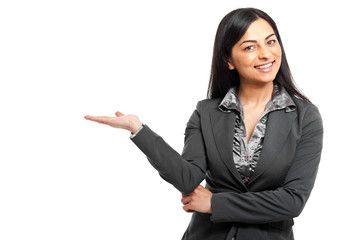 Smiling businesswoman showing her empty hand