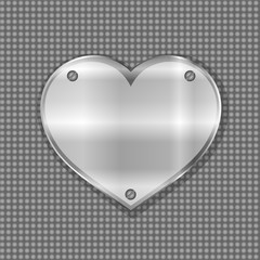 metal heart label on steel background
