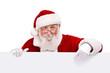 Leinwandbild Motiv Santa pointing in white sign