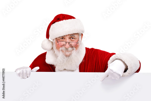 Santa pointing in white sign - 44771903