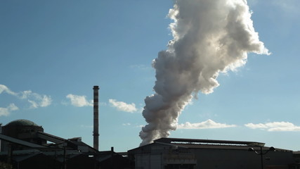 Water vapor column rising up from factory