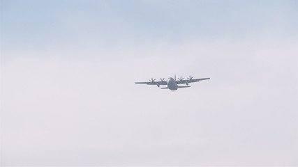 Military aircraft C-130 Hercules flying in the sky