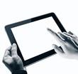 Leinwandbild Motiv Hands holding tablet