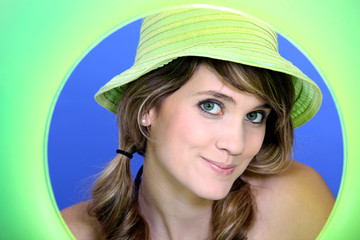 Attractive woman wearing a green hat