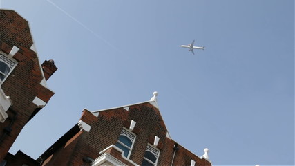 Plane flying over houses in London