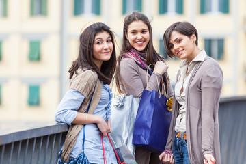 Three Beautiful Young Women with Shopping Bags