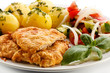 Pork chops, boiled potatoes and vegetable salad