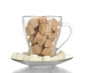 white refined sugar and Lump brown cane sugar cubes in glass