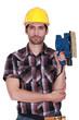 Portrait of a handyman holding a sander