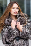 Portrait of pretty female in fashionable coat
