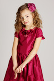 Portrait of little pretty girl in red dress