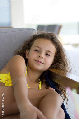Portrait Of A Beautiful Young Girl In A Yellow Bikini