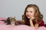 happy cute five year old girl with her cat