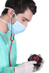 Wealthcheck: Doctor checking a woman's purse with a stethoscope
