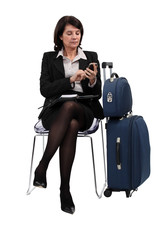 Seated Woman with suitcases
