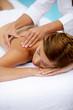 Woman receiving a poolside back massage