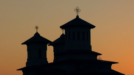 Old Christian Church in sunset (silhouette)...