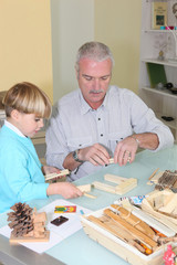 Father and son building a wooden toy