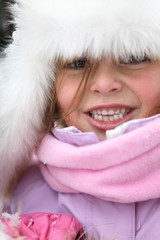 Cute little girl in snowsuit