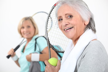 Women going to play tennis
