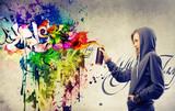 Fototapety Blonde girl making a very colorful graffiti