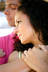 Young couple in a restful embrace
