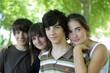 Four children stood together in park