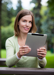 Woman in Park with Digital Tablet