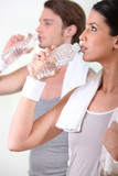 a couple drinking water after sport