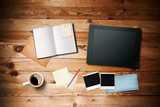 Workspace with coffee cup,  tablet pc, instant photos, note pape poster