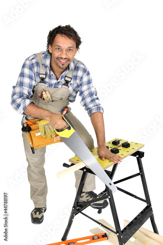 Man sawing a plank of wood